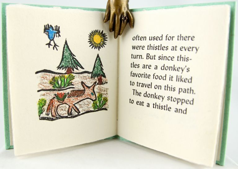 An Aesop's Fable: The Donkey & The Thistle. Aesop.