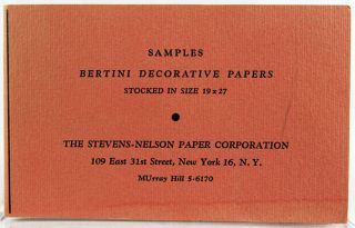 Two commercial paper sample books.